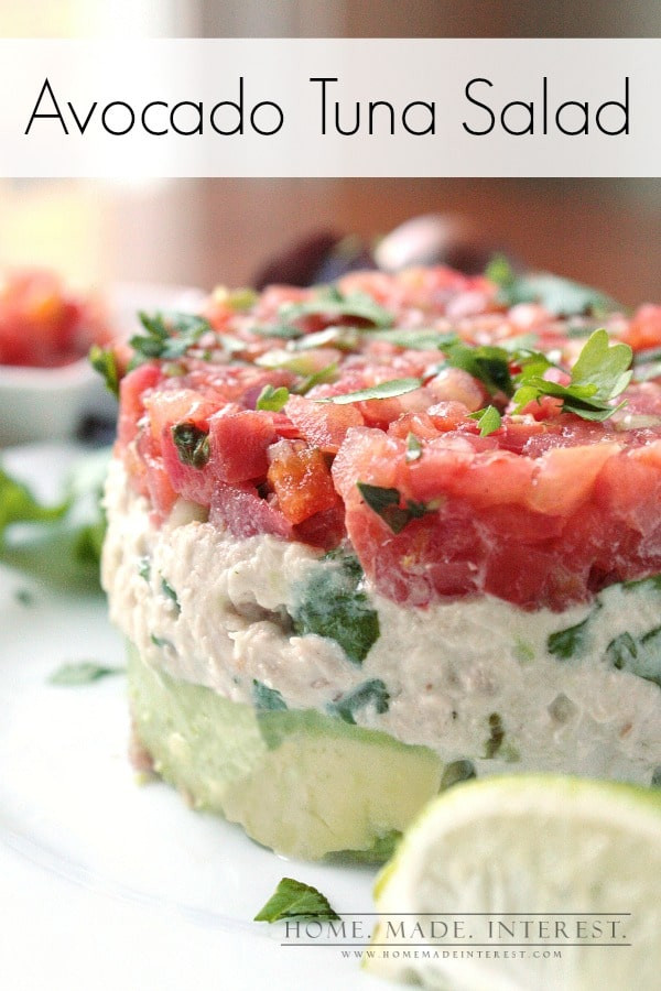 tuna salad stacked on top of avocado and topped with salsa