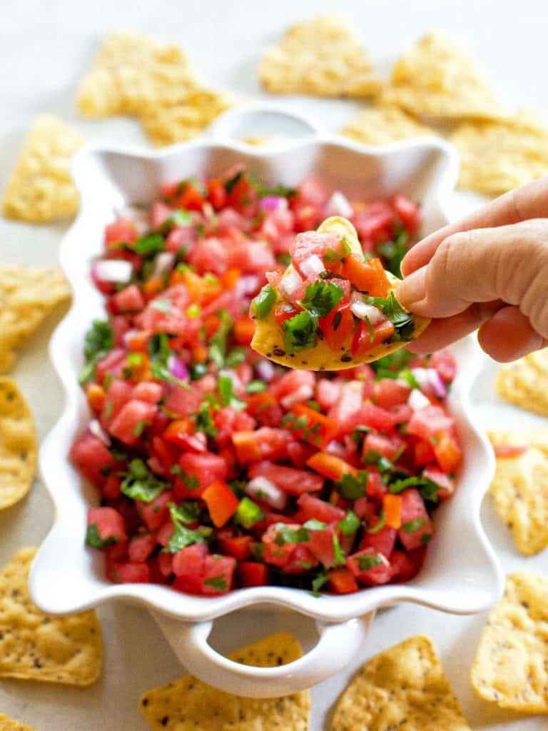 watermelon salsa in a tray surrounded by tortilla chips