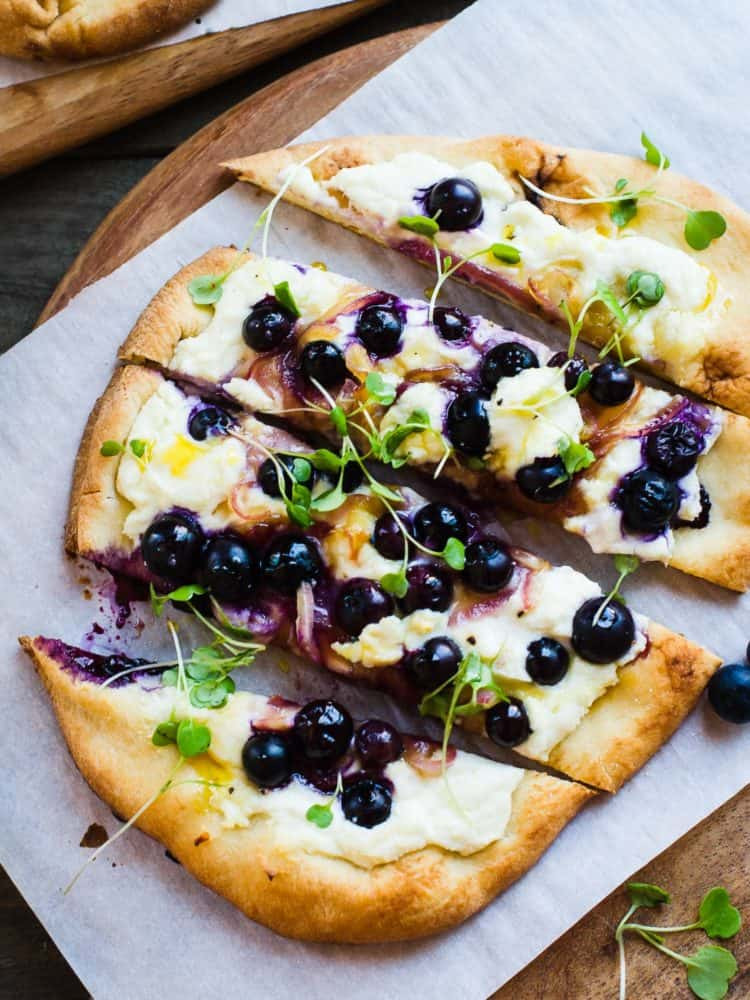 blueberry feta and honey pizza on naan bread