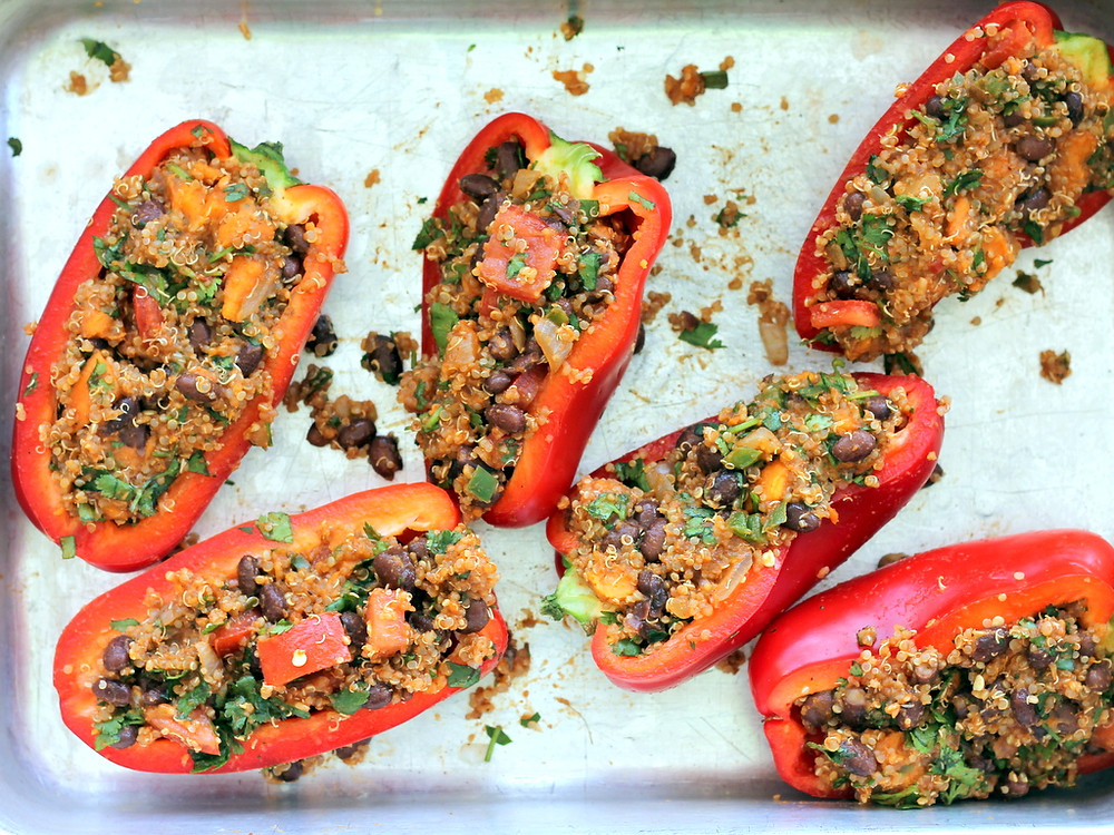red peppers stuffed with beans quinoa and potatoes