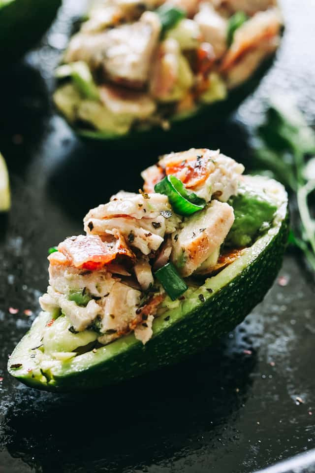 half an avocado stuffed with chicken and bacon