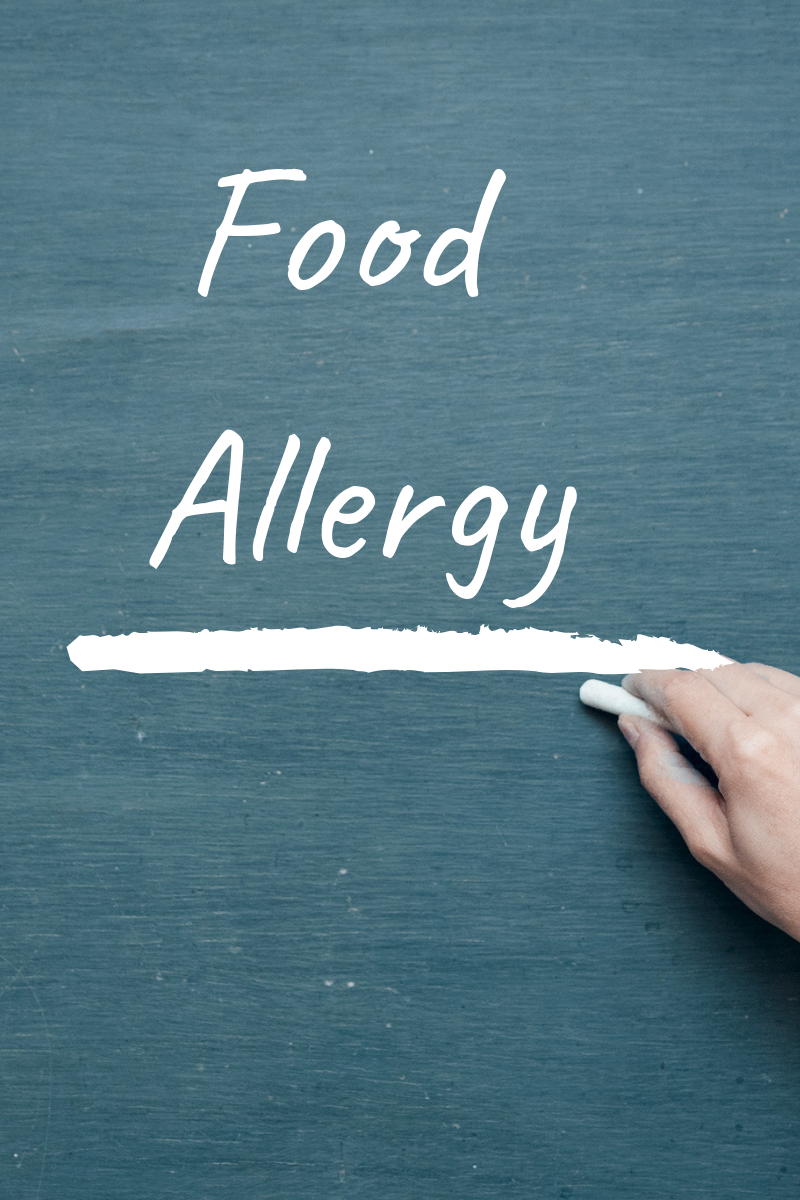 the words food allergy written on a chalkboard