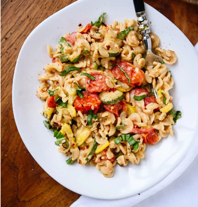 creamy cherry tomato and summer squash pasta is summer on a plate