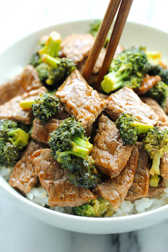 beef and broccoli in a bowl on rice
