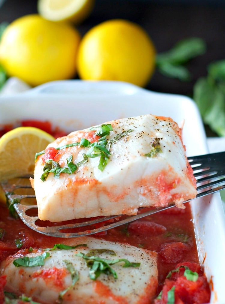 baked white fish with tomato sauce and basil