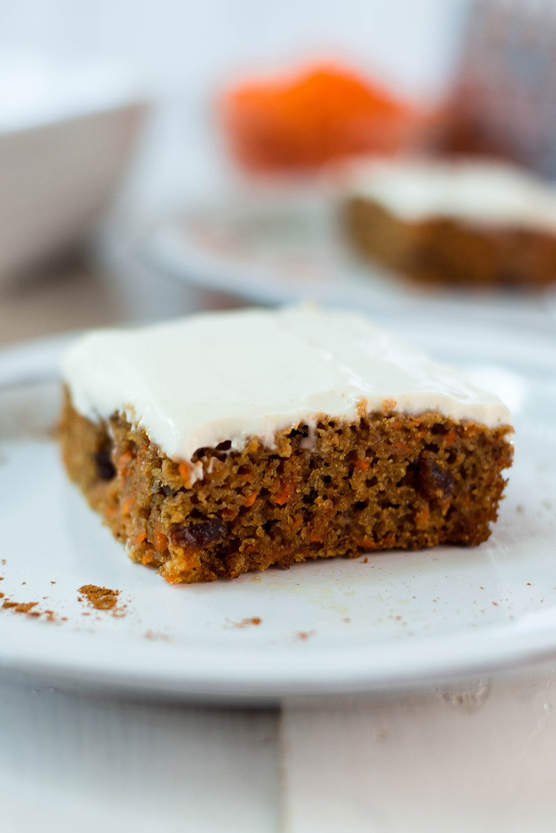 carrot cake with frosting on a plate