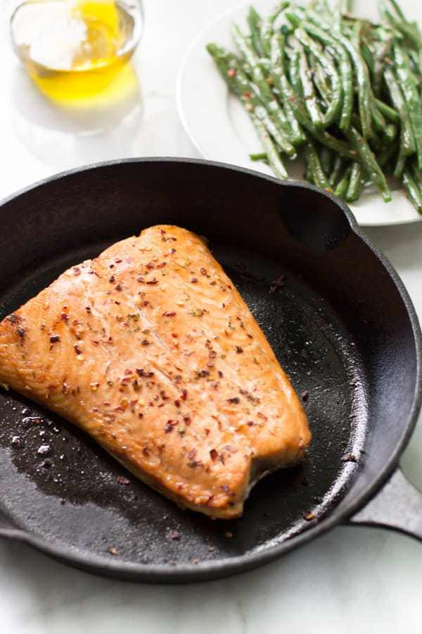 salmon in a cast iron pan