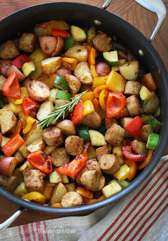 summer vegetables with sausage and potatoes recipe in a pan