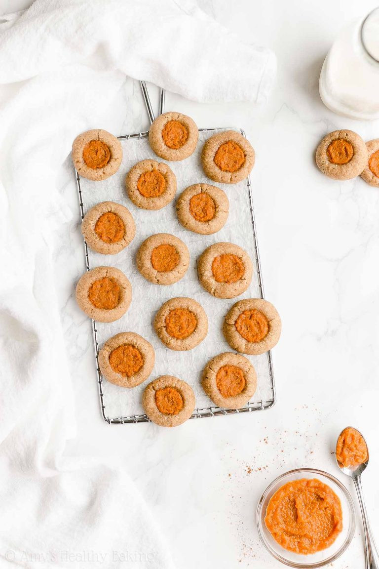 pumpkin pie thumbprint cookies on a table