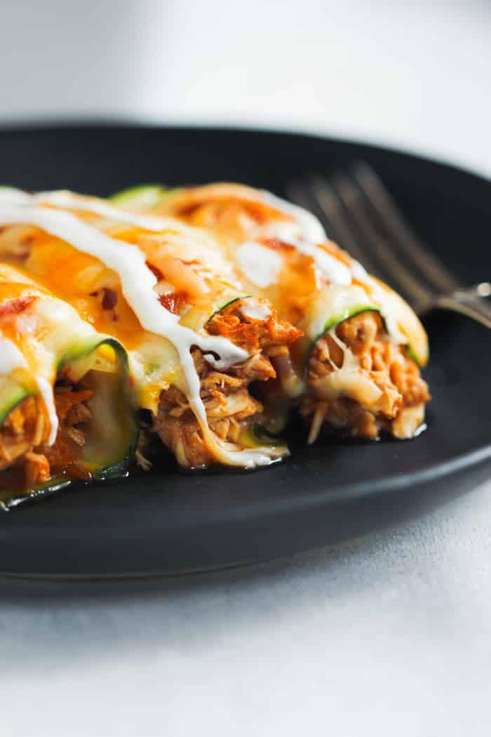 chicken zucchini enchiladas on a plate