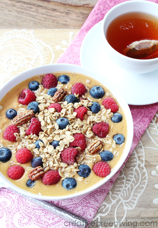 smoothie bowl with blueberries, raspberries and granola on top