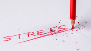 the word stress written out in red pencil on paper