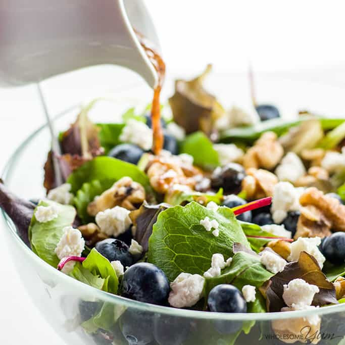 mixed green salad with blueberries, feta and walnuts