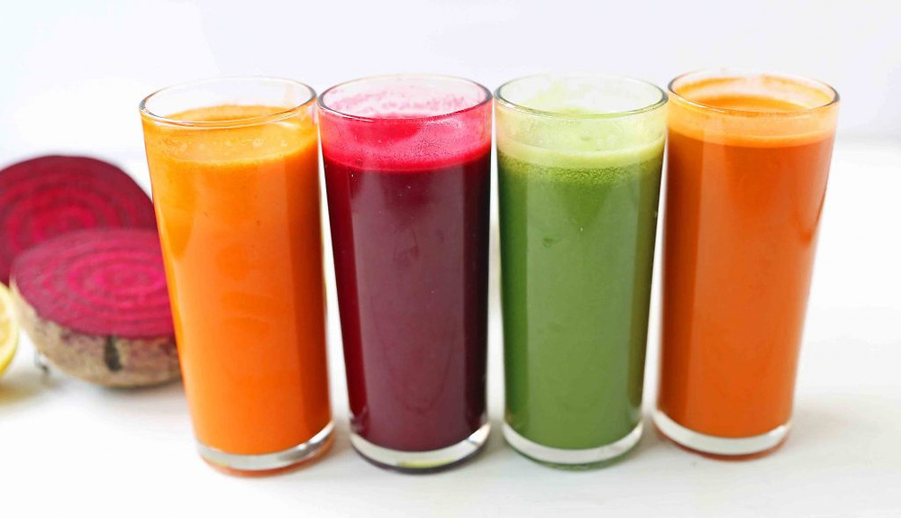 4 vegetable juices in glasses ready to drink