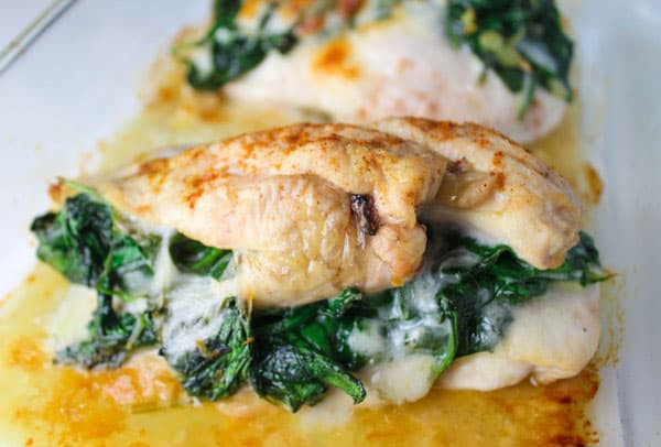 baked chicken breasts stuffed with spinach and cheese on a plate