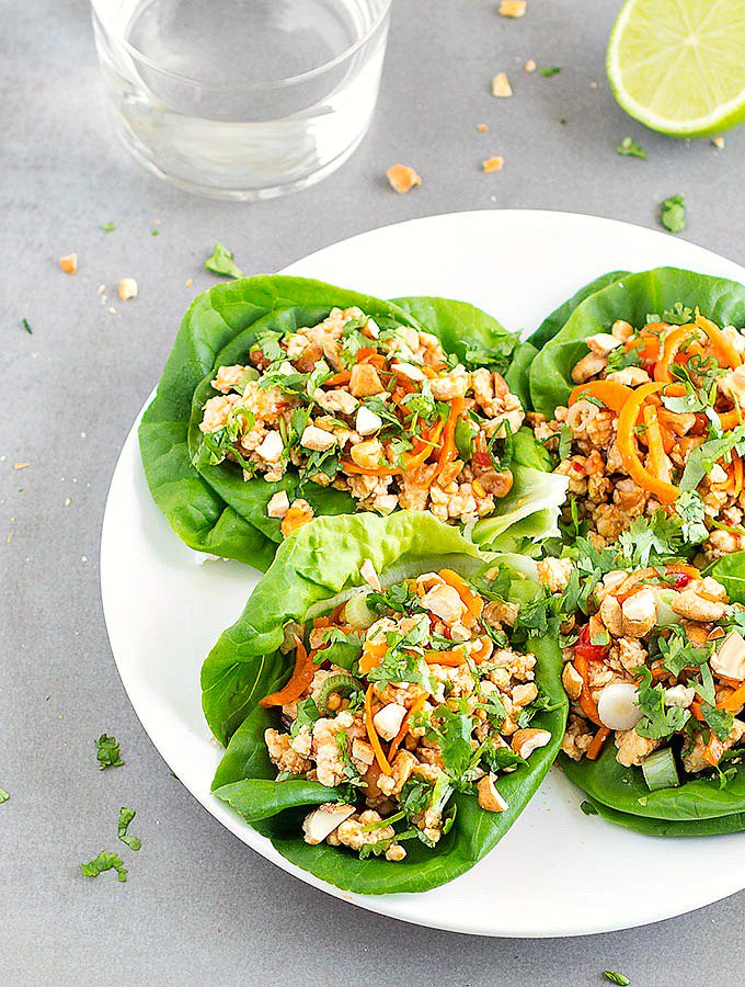 lettuce wraps with chicken cashews and shredded carrots