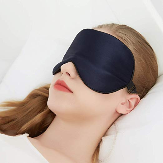 woman with a sleeping mask
