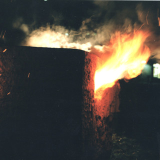 burning earth hut
