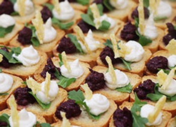 Parmesan wafer, olive tapenade and goat cheese crostini square