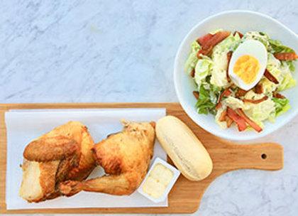 BBQ chicken with caesar salad and fresh rolls