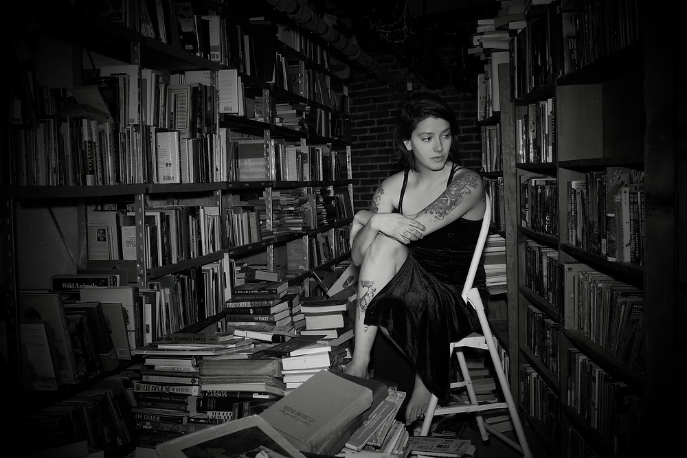 Photo by Michael Crook, me and my book mess.