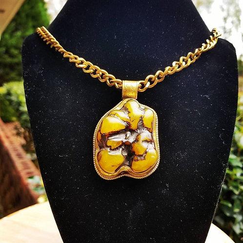 Honey Amber pendant in Tibetan Repoussé on 18 inch antique