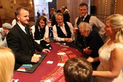 Groom dealing blackjack