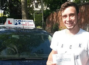 young-man-happy-passed-drivin-test-with-kp-driving-lessons