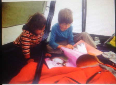 Catching sibling love on candid camera- Kale reading Elijah a book in his tent while camping!
