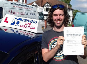 man-happy-passed-drivin-test-with-kp-driving-lessons