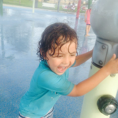 Elijah having fun at the water playground!