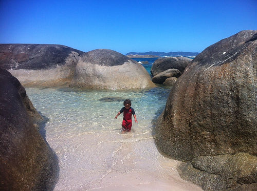 Elijah exploring at Green's Pool in an oversized wetsuit!