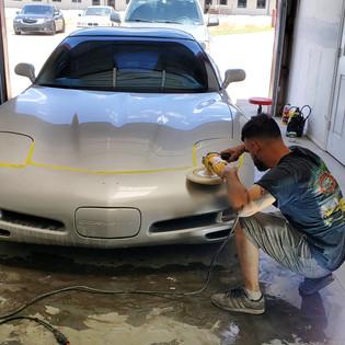 Man Buffing a Corvette