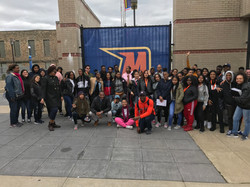 Group of students and staff in front of Morgan State University
