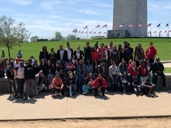 Group of students and staff in front of the Washington Monument
