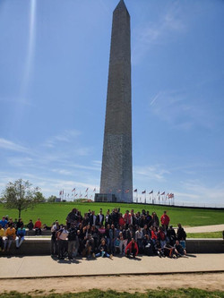 Group of students standing in front of the Washington Monument.