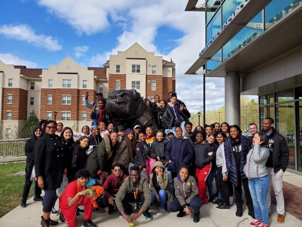 Group of students and staff in front of the Bulldog at Bowie State University