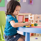 Young child playing at table