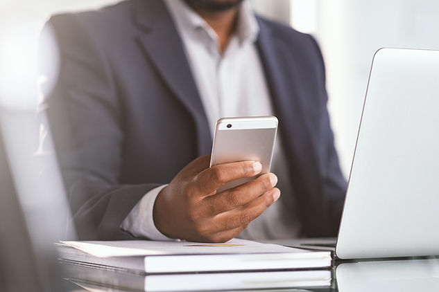 close-up-hand-of-businessman-using-phone-2021-04-03-13-38-42-utc.jpg