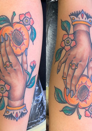 Hand Holding Peach Tattoo