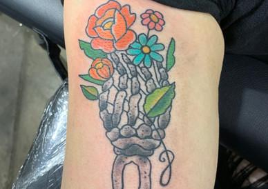 Skeleton Hand holding Flowers