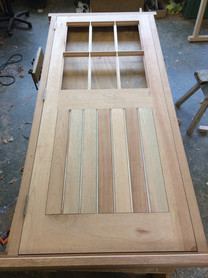 Boarded door with glazed top section