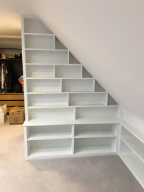 Bookcase on scaling ceiling