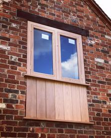 Oak window with boarding