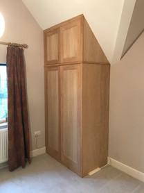 Oak wardrobe to scaling ceiling