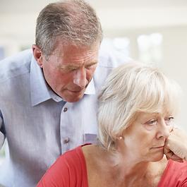 elderly man speaking to lady with alzheimer's disease