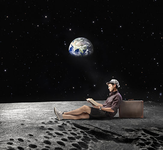 Young man sitting on the Moon and readin