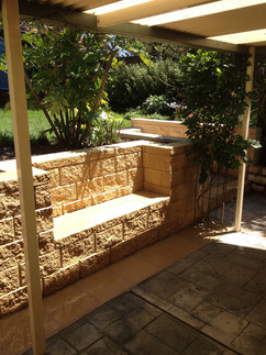 Block retaining wall with seating