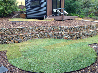 Tiered rock walls with steel edging