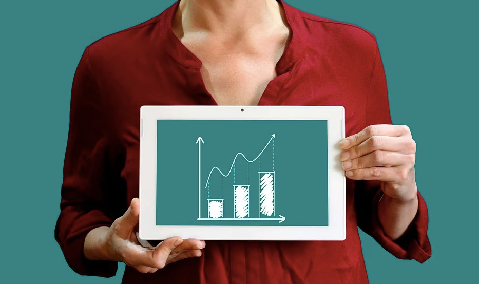 Woman holding a tablet showing a graph